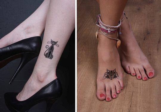Татуировка кота на ноге у девушки