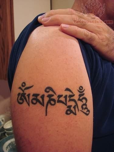Religious buddhist tattoo design on biceps ...