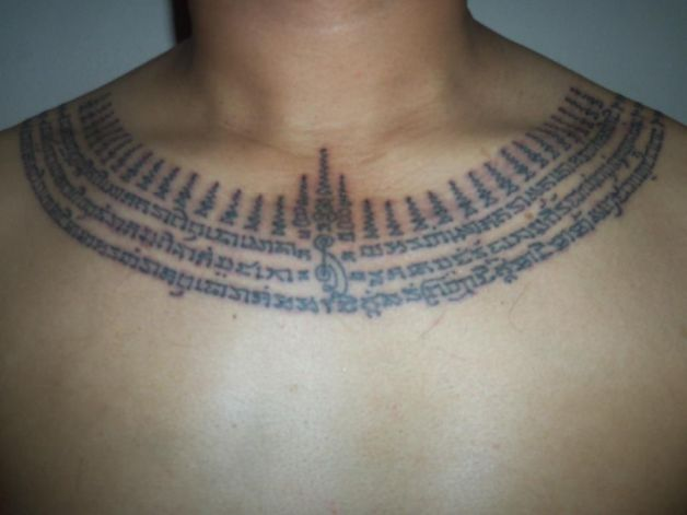 Religious buddhist tattoo design on chest for Religious chest tattoos