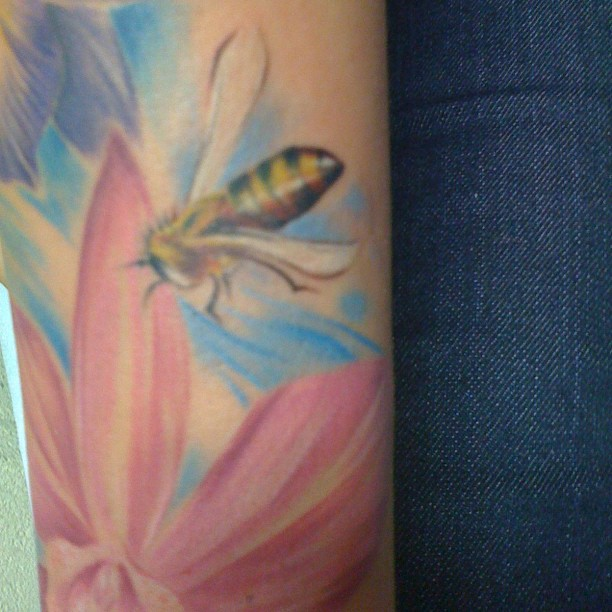 Elegant Bee And Pink Flower Tattoo On Arm