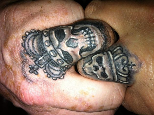 Matching red king and queen finger tattoos for couple for Matching king and queen tattoos