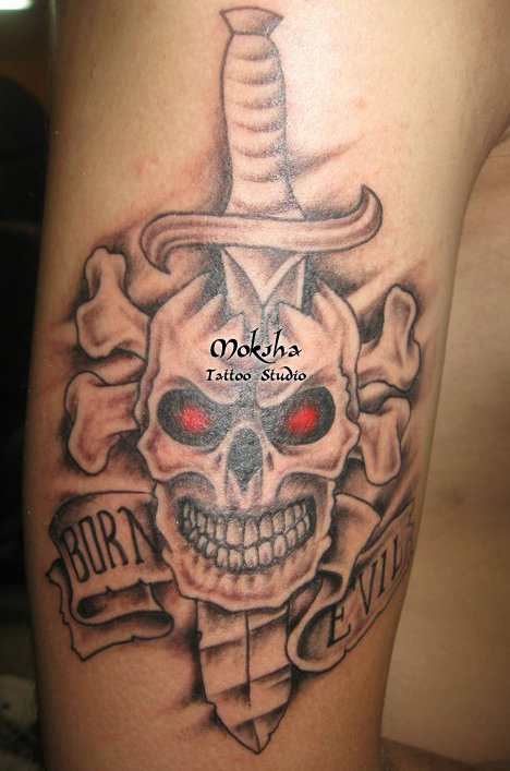 Red Eyes Skull And Dagger Tattoo On Bicep
