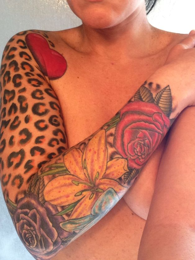 Sleeve Of Leopard Prints And Pin Up Girl Tattoos