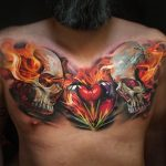 Flaming Glass Heart Tattoo On Chest