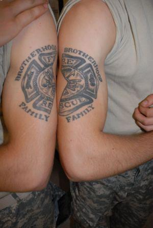 Army Fire Fighter Tattoo On Muscles