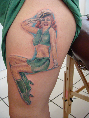 Probably the most classic is the old sailor pinup girl tattoo with an anchor. Other common add ons are good luck tattoo like dice, cards, horseshoe and etc.