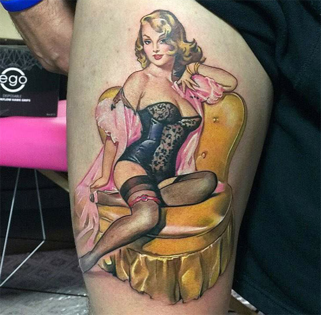 This pin-up tattoo seems to have some tattoos of her own 2