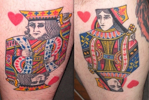Two tattoos that depict typical playing card designs for the King and Queen of Hearts
