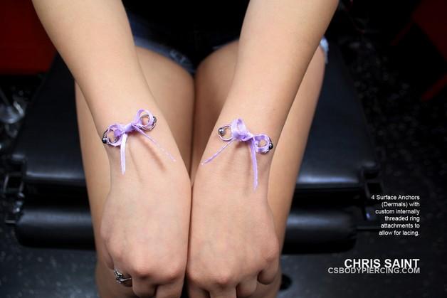 3D Autistic Ribbon Tattoo On Wrist photo - 1
