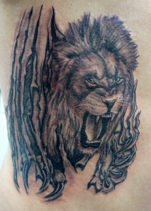 Angry Ripped Skin Tiger Tattoo For Arm photo - 1