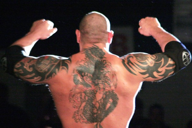 Batistas Biceps Tattoo photo - 1