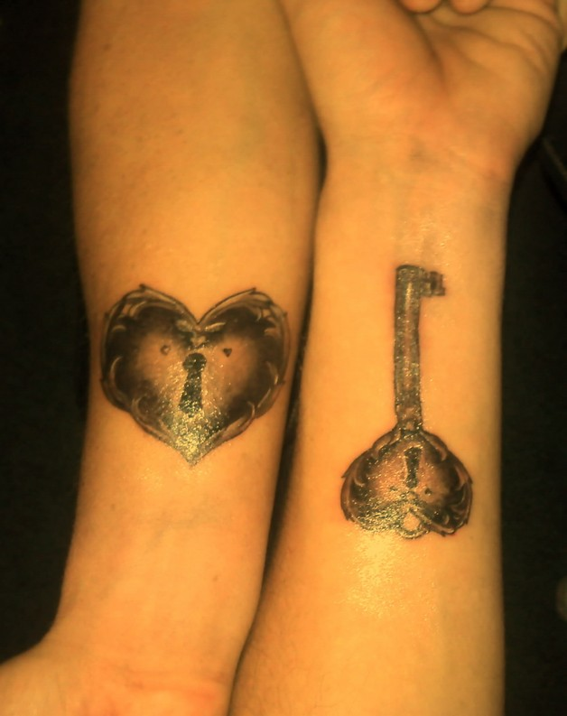 Beautiful Queen of Hearts Tattoo On Arm photo - 1