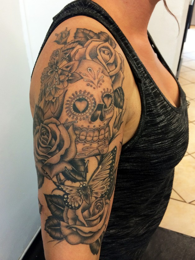 Black And White Mexican Skull Tattoo On Upper Back photo - 1