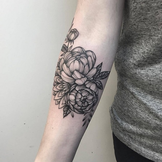 Black flowers tattoo on forearm for Flower tattoos on lower arm