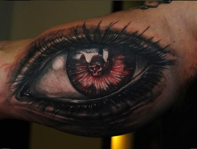 Black Ink Text Tattoo On Biceps photo - 1