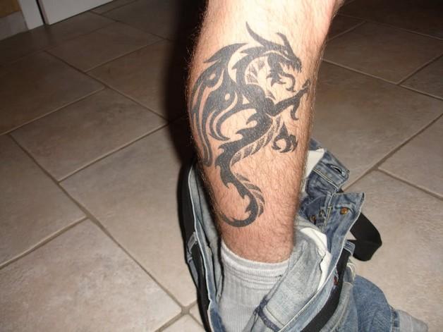 Black Ink Tiger Tattoo For Leg photo - 1