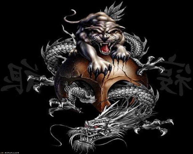 Black Ink Yin Yang Dragons Tattoo On Shoulder photo - 1