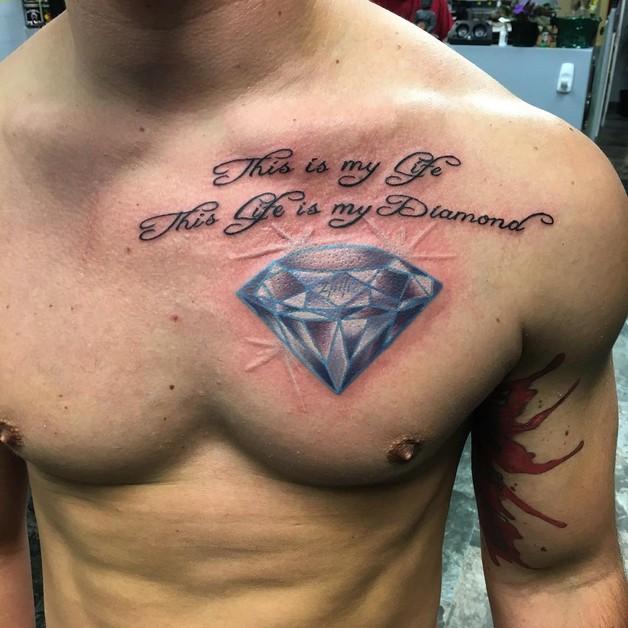 Blue Diamond Tattoo On Upper Back photo - 1