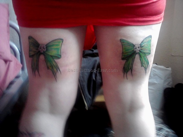 Blue Ribbon Bow Tattoos On Back Of Thighs photo - 1