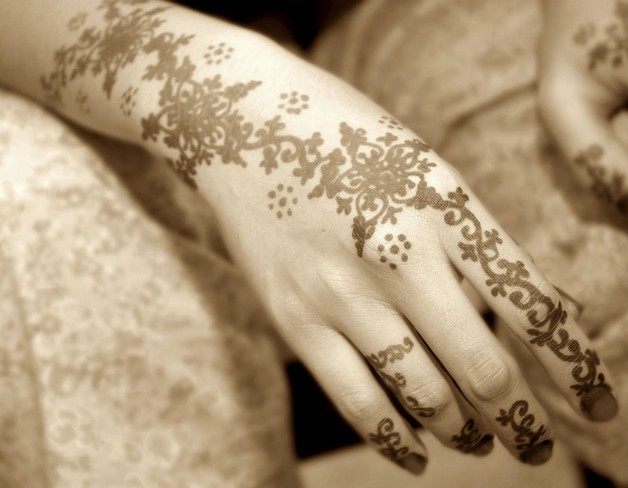 Cara Hand Tattoo Design photo - 1