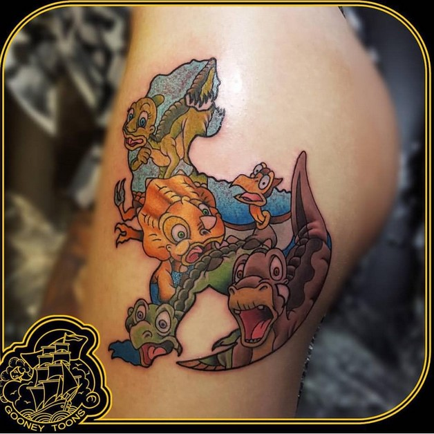 Cartoon Bee Tattoo On Biceps photo - 1