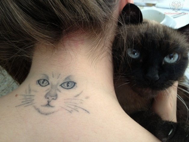 Cat Eyes Tattoo On Back photo - 1