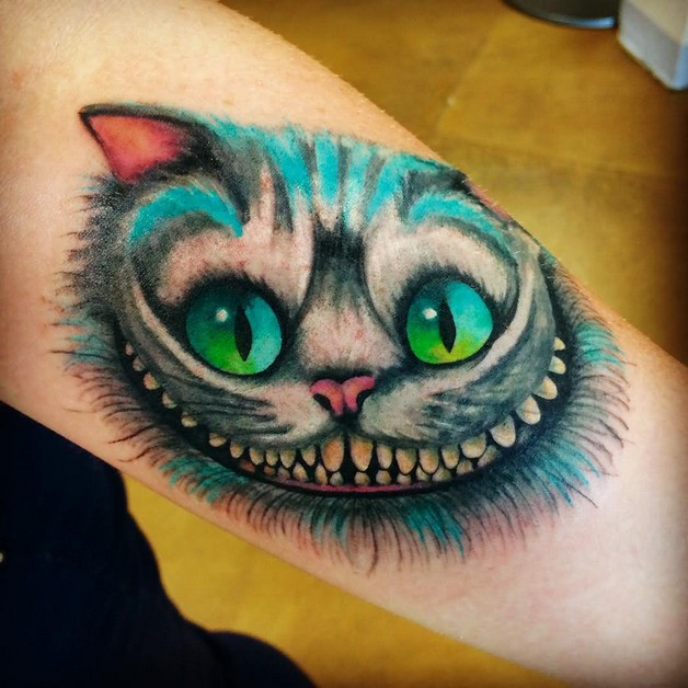 Cheshire Cat Tattoo On Biceps photo - 1