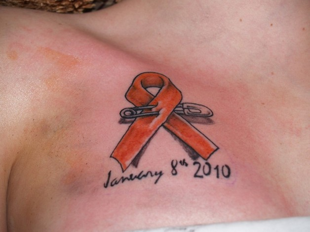 Clean Cancer Ribbon Tattoo On Chest photo - 1