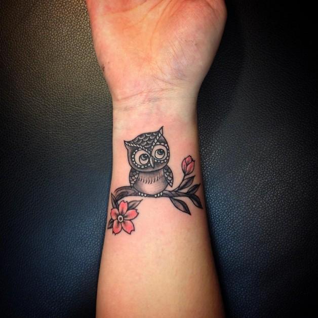 Cute Black Ink Rabbit Tattoo On Wrist photo - 1