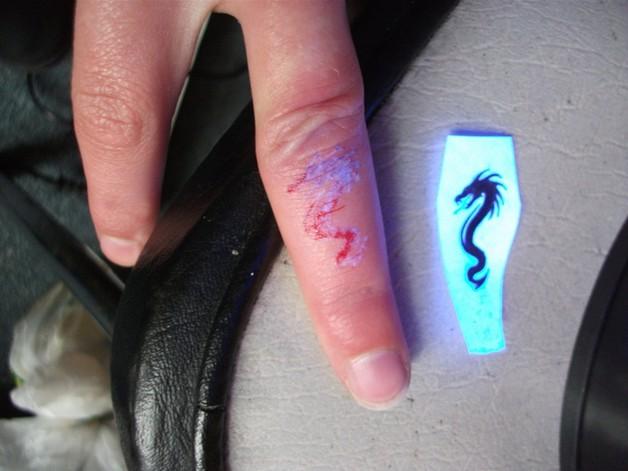 Cute Dagger Tattoo On Face photo - 1