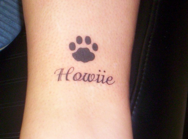 Cute Rabbit With Foot Print Tattoos On Foot photo - 1