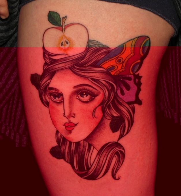 Cutted Apple & Cartoon Tattoo On Biceps photo - 1