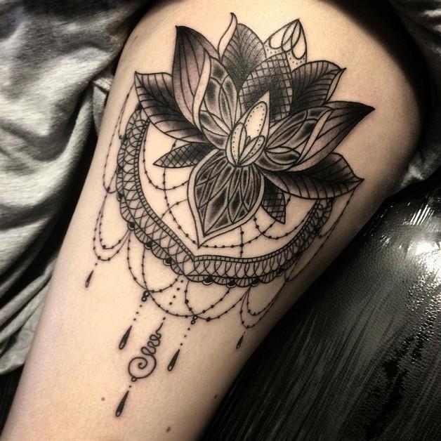 Elegant Lotus Flower Tattoo On Lower Back photo - 1