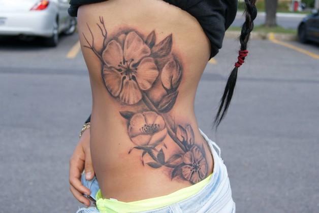 Flower Tattoo For Men On Rib Side photo - 1