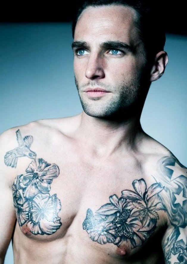 Flower Tattoo On Chest Of Man photo - 1