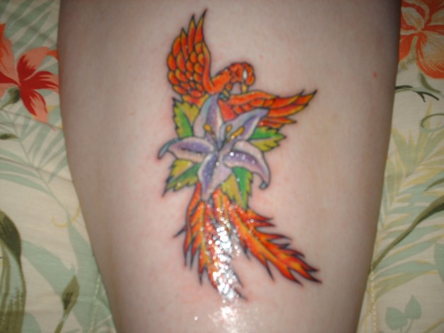 Flowers And Literary Tattoo On Back Body photo - 1