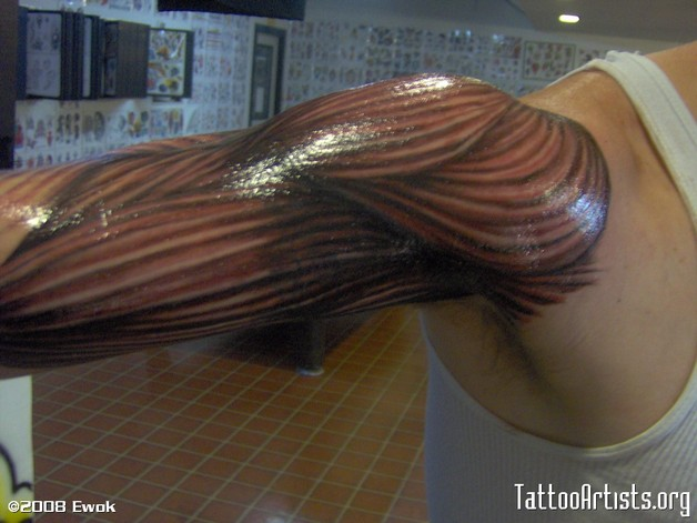 Glowing Alien Tattoo For Biceps photo - 1