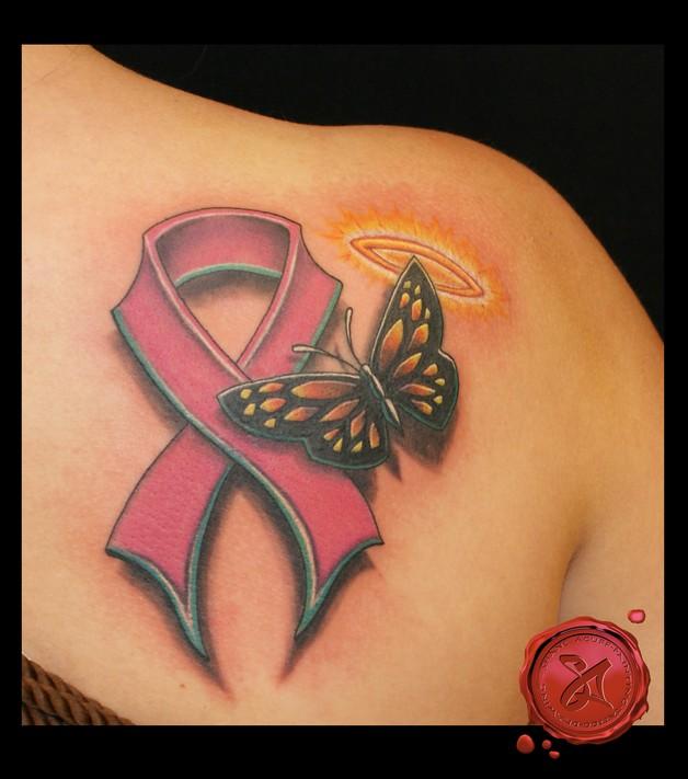 Gorgeous Pink Ribbon Tattoo On Lowerback photo - 1