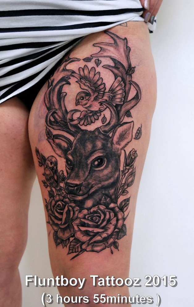 Green Ink Bottle Tattoo With Flowers On Thigh photo - 1