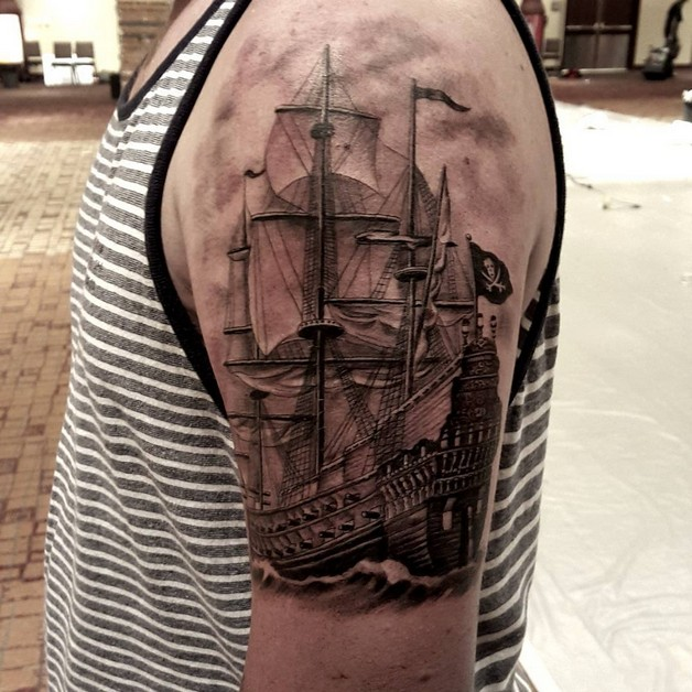 Grey Ink Bottle With Ship Tattoo On Arm photo - 1