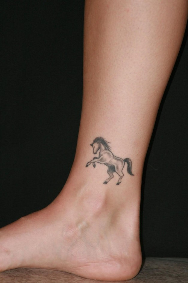 Grey Ribbon Bow Tattoo On Ankle photo - 1