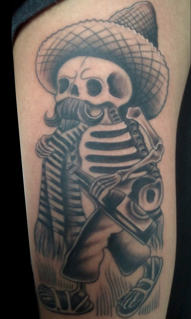 Mexican Style Skull Tattoo On Lower Arm photo - 1