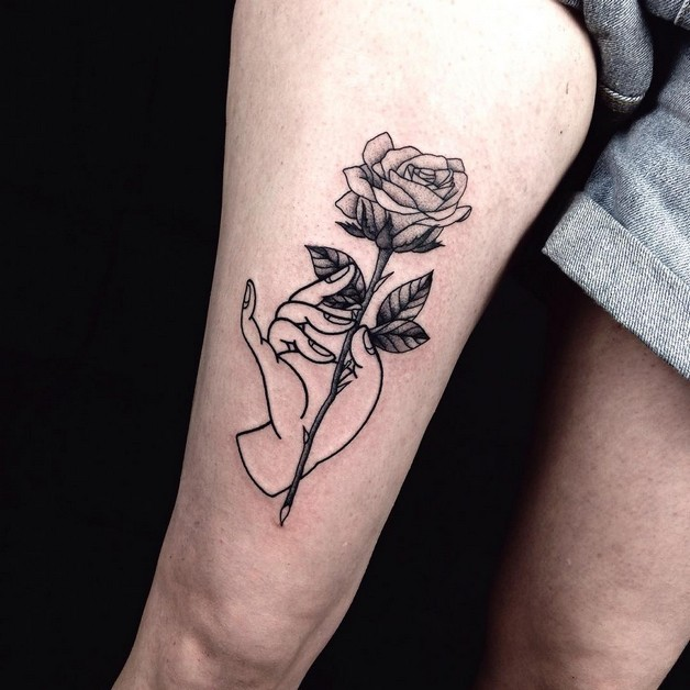 Old school pinup on red rose tattoo on thigh for Red rose tattoo meaning