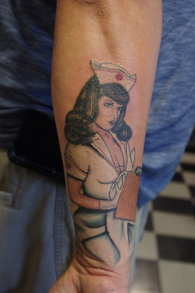 Pin Up Nurse Tattoo On Arm photo - 1