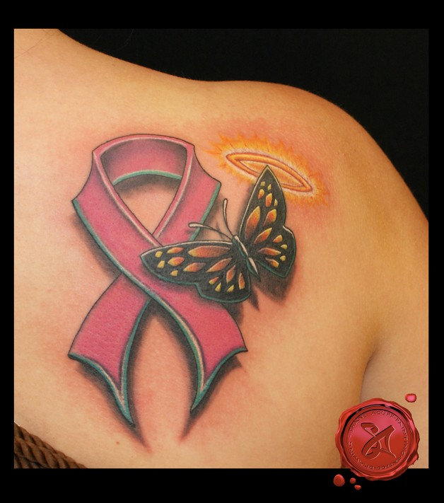 Red Ribbon With Safety Pink Tattoo On Chest photo - 1
