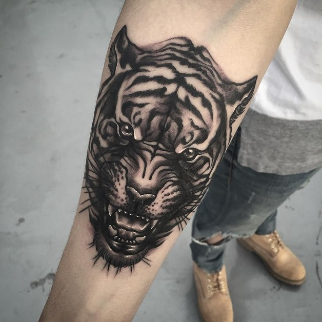 Right Half Sleeve Tiger Ripped Skin Tattoos photo - 1
