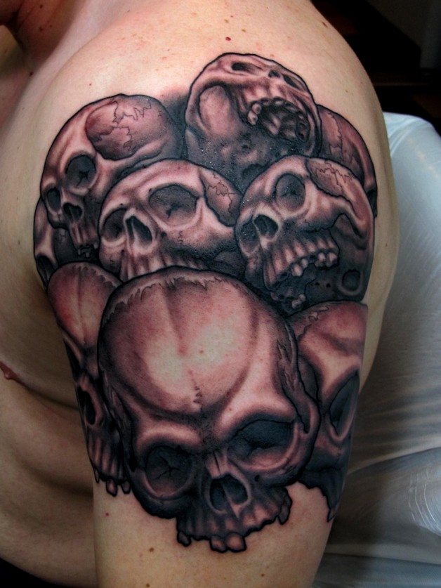 Skull With Dagger Tattoo On Forearm photo - 1