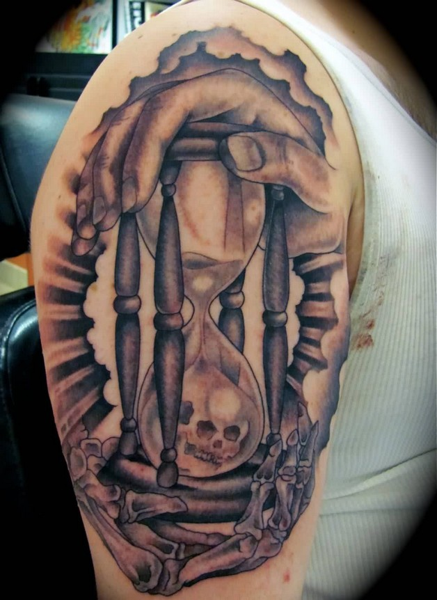 Skull With Man Reaching For Hour Glass Tattoo On Half Sleeve photo - 1