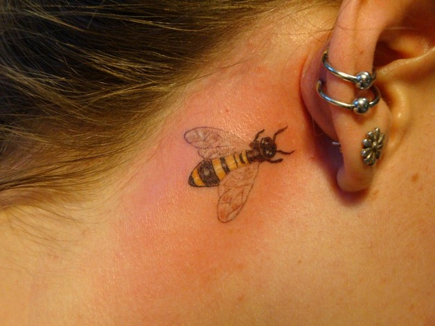 Small Bees Tattoo Behind Ear photo - 1