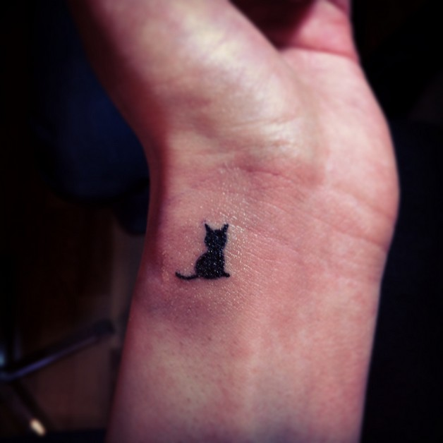 Small Kitties Cat Tattoo on Arm photo - 1